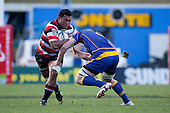 Viliami Fihaki runs into the tackle of Paul Grant. ITM Cup Round 1 game between the Counties Manukau Steelers and Otago, played at Bayer Growers Stadium, Pukekohe, on Saturday July 31st 2010. Counties Manukau Steelers won 29 - 13 after leading 22 - 6 at halftime.