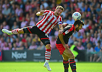 Lincoln City's Lee Frecklington vies for possession with Swindon Town's Michael Doughty<br /> <br /> Photographer Andrew Vaughan/CameraSport<br /> <br /> The EFL Sky Bet League Two - Lincoln City v Swindon Town - Saturday August 11th 2018 - Sincil Bank - Lincoln<br /> <br /> World Copyright &copy; 2018 CameraSport. All rights reserved. 43 Linden Ave. Countesthorpe. Leicester. England. LE8 5PG - Tel: +44 (0) 116 277 4147 - admin@camerasport.com - www.camerasport.com