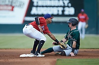 Piedmont Boll Weevils shortstop Lenyn Sosa (2) tags out Patrick Dorrian (15) of the Greensboro Grasshoppers as he attempts to steal second base at Kannapolis Intimidators Stadium on June 16, 2019 in Kannapolis, North Carolina. The Grasshoppers defeated the Boll Weevils 5-2. (Brian Westerholt/Four Seam Images)