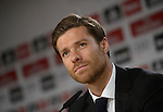 Real Madrid's midfielder Xabi Alonso gestures during a press conference at the Santiago Bernabeu stadium in Madrid on August 29, 2014 .  PHOTOCALL3000/DP