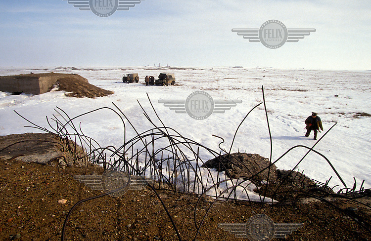 © Paul Lowe / Panos Pictures..Semipalatinsk, KAZAKHSTAN. ..Looking towards the exact epicentre of the 1949 and 1953 explosions.  The bunkers in the picture were built deliberately to test the force of the explosion...On 29th August 1949 the first Russian plutonium bomb was exploded at the Semipalatinsk nuclear test site, which came to be known as 'The Polygon'. This first detonation was followed by more than 500 nuclear explosions, both atmospheric and underground..The effects in the Semipalatinsk region have been devastating. According to the UN more than 1.2 million people have been contaminated or are living in severely contaminated areas. Of these over 100,000 suffer from radiation related diseases. Even though testing stopped in 1989 the situation is continuing to deteriorate. Two out of every three children born in the region suffer from genetic defects.