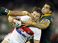 PICTURE BY VAUGHN RIDLEY/SWPIX.COM - Rugby League - Rugby League World Cup 2008 - England v Australia - Telstra Dome, Melbourne, Australia - 02/11/08...Copyright - Simon Wilkinson - 07811267706...England's Martin Gleeson is tackled by Australia's Greg Inglis.