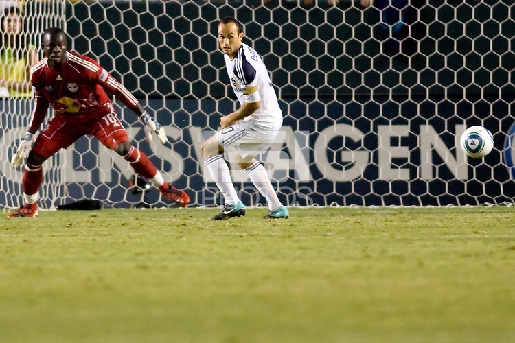 LA Galaxy midfielder & captain Landon Donovan attempts to head a ball past Bouna Coundoul GK of the New York Red Bulls. The New York Red Bulls beat the LA Galaxy 2-0 at Home Depot Center stadium in Carson, California on Friday September 24, 2010.
