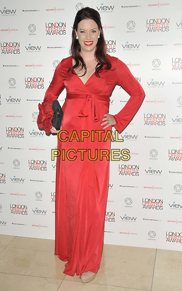 Sharon Marshall.The London Lifestyle Awards 2011, Park Plaza Riverbank hotel, Albert Embankment, London, England..October 6th, 2011.full length red dress long sleeves hand on hip black clutch bag.CAP/CAN.©Can Nguyen/Capital Pictures.