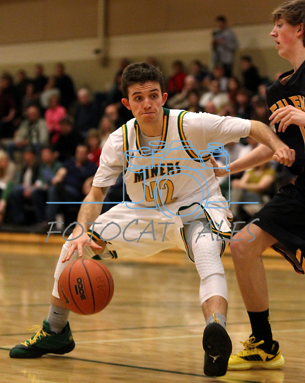 Manogue's Remy Dillard competes against Galena at Manogue High School in Reno, Nev., on Tuesday, Feb. 11, 2014. Manogue won 66-59.<br /> Photo by Cathleen Allison