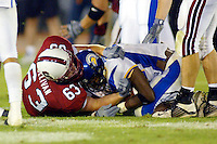 Mike Sullivan makes a tackle after an interception during Stanford's 63-26 win over San Jose State on September 14, 2002 at Stanford Stadium.<br />