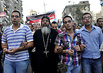 Egyptian Coptic Christians hold crosses and shout slogans, during a protest in Shubra, Cairo, 09 October 2011. According to media report, hundreds of Coptic Christians on 09 October, demonstrated outside the state television building in central Cairo, in protest at the destruction of a church in the southern Egyptian province of Aswan. Photo by Ahmed Asad