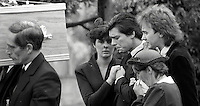 Pix: Copyright Anglia Press Agency/Archived via SWpix.com. The Bamber Killings. August 1985. Murders of Neville and June Bamber, daughter Sheila Caffell and her twin boys. Jeremy Bamber convicted of killings serving life...copyright photograph>>Anglia Press Agency>>07811 267 706>>..Jeremy Bamber, is comforted by his girlfriend Julie Mugford, alongside Colin Caffell, father and husband of victims, at funeral. no date..ref 0006 neg 22.