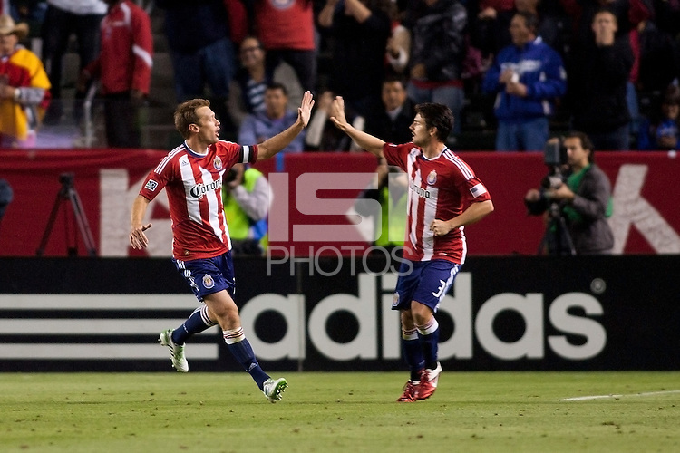 Chivas USA defender Jimmy Conrad (12) is congratulated by teammate Heath Pearce (3) after scoring his goal. Sporting KC defeated CD Chivas USA 3-2 at Home Depot Center stadium in Carson, California on Saturday March 19, 2011...
