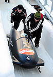 18 December 2010: Shauna Rohbock's sled is pushed up the track after a turnover during her second run for the USA at the Viessmann FIBT World Cup Bobsled Championships on Mount Van Hoevenberg in Lake Placid, New York, USA. Neither Rohbock nor her brakeman Valerie Fleming suffered any injuries. Mandatory Credit: Ed Wolfstein Photo