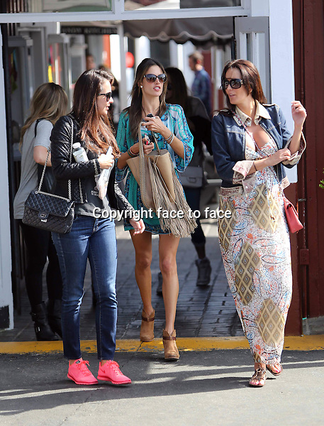 Alessandra Ambrosio seen in a summerly dress and with cool bohemian fringe tote at the Brentwood Country Mart. Los Angeles, California on March 22, 2013...Credit: Vida/face to face