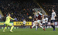 Burnley's James Tarkowski touches a close range effort over the crossbar under pressure from Everton's Jordan Pickford<br /> <br /> Photographer Rich Linley/CameraSport<br /> <br /> The Premier League - Burnley v Everton - Wednesday 26th December 2018 - Turf Moor - Burnley<br /> <br /> World Copyright &copy; 2018 CameraSport. All rights reserved. 43 Linden Ave. Countesthorpe. Leicester. England. LE8 5PG - Tel: +44 (0) 116 277 4147 - admin@camerasport.com - www.camerasport.com