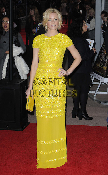 Elizabeth Banks.European Premiere of 'The Hunger Games' at Cineworld at the O2 Arena, London, England..March 14th 2012.full length yellow dress clutch bag sequins sequined  hand on hip.CAP/CAN.©Can Nguyen/Capital Pictures.