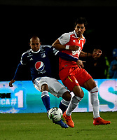 BOGOTÁ - COLOMBIA, 20-01-2019: Facundo Guichón (Der.) jugador de Independiente Santa Fe disputa el balón con Juan Pérez (Izq.) jugador de Millonarios, durante partido entre Independiente Santa Fe y Millonarios, por el Torneo Fox Sports 2019, jugado en el estadio Nemesio Camacho El Campin de la ciudad de Bogotá. / Facundo Guichón (R) player of Independiente Santa Fe vies for the ball with con Juan Perez (L) player of Millonarios, during a match between Independiente Santa Fe and Millonarios, for the Fox Sports Tournament 2019, played at the Nemesio Camacho El Campin stadium in the city of Bogota. Photo: VizzorImage / Luis Ramírez / Staff.