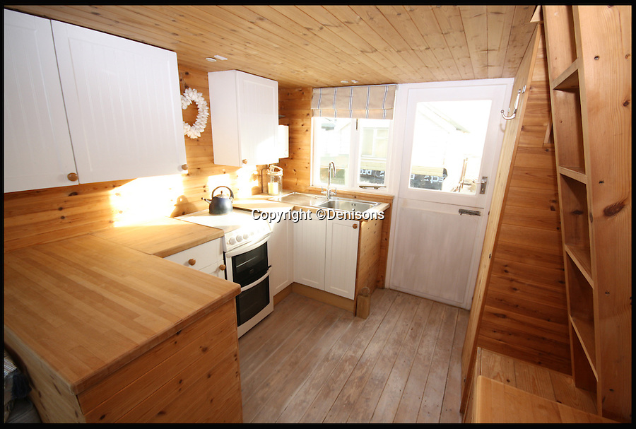 BNPS.co.uk (01202 558833)<br /> Pic: Denisons/BNPS<br /> <br /> *Please use full byline*<br /> <br /> The kitchen area of hut 224, on sale for £225,000.<br /> <br /> These five timber beach huts with no bathroom or mains electricity would set you back more than £1million altogether.<br /> <br /> Asking prices for the tiny shacks range from £185,000 to £240,000, the same cost as a three-bedroom house in some parts of the country.<br /> <br /> The huts are all in the desirable location of Mudeford Spit near Christchurch in Dorset, which can only be accessed by ferry or a ride on a novelty land train.