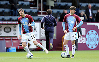 Burnley's Stephen Ward (left) and Anthony Driscoll-Glennon during the pre-match warm-up <br /> <br /> Photographer Rich Linley/CameraSport<br /> <br /> The Premier League - Burnley v Manchester City - Sunday 28th April 2019 - Turf Moor - Burnley<br /> <br /> World Copyright © 2019 CameraSport. All rights reserved. 43 Linden Ave. Countesthorpe. Leicester. England. LE8 5PG - Tel: +44 (0) 116 277 4147 - admin@camerasport.com - www.camerasport.com