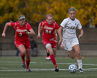 Boston College midfielder Kristen Mewis (19) on the attack as Marist College midfielder/defender Jamie Strumwasser (3) and Marist College forward/midfielder Amanda Epstein (24) close. Boston College defeated Marist College, 6-1, in NCAA tournament play at Newton Campus Field, November 13, 2011.