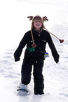 young girl snowshoeing
