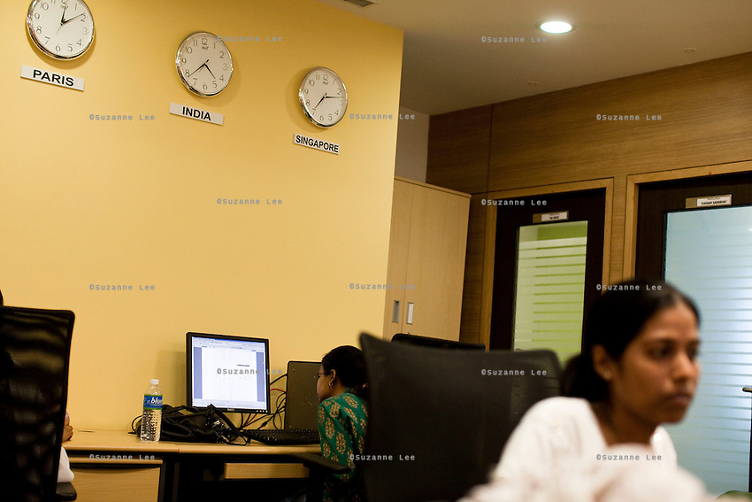 ALSTOM's employees at work amongst wall clocks showing multiple timezones in the office in Bangalore, Karnataka, India on 10th March 2011. .Photo by Suzanne Lee/Abaca Press