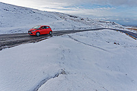 WEATHER PICTURE WALES<br /> Pictured: A car travels on the snow covered A4069 in the Black Mountains near Brynamman, Wales, UK. Wednesday 23 January 2019