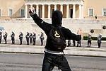 Protesters clash with riot police. General strike from the civil servants paralyzing the public sector in a protest over ever-deeper austerity measures applied as the government struggles to avoid a catastrophic default.