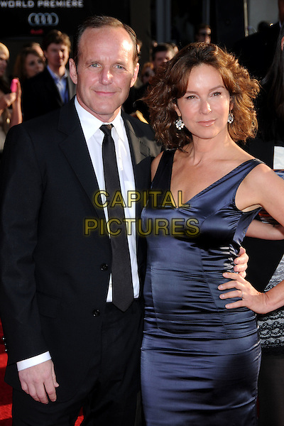 "CLARK GREGG & JENNIFER GREY .""Iron Man 2"" World Premiere held at the El Capitan Theatre, Hollywood, California, USA, 26th April 2010..arrivals half length blue navy dress couple husband wife married black suit tie hand on hip sleeveless silk satin .CAP/ADM/BP.©Byron Purvis/AdMedia/Capital Pictures."