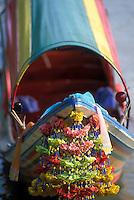 Garland hanging from bow of colorful river boat, Bangkok, Thailand