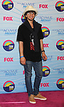 UNIVERSAL CITY, CA - JULY 22: Adam Sevani poses in the press room at the 2012 Teen Choice Awards at Gibson Amphitheatre on July 22, 2012 in Universal City, California.
