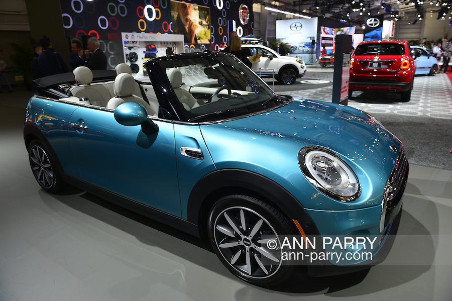 A blue MINI John Cooper Works Convertible makes its world premiere at the New York International Auto Show 2016, at the Jacob Javits Center. This was Press Preview Day one of NYIAS, and the Trade Show will be open to the public for ten days, March 25th through April 3rd.