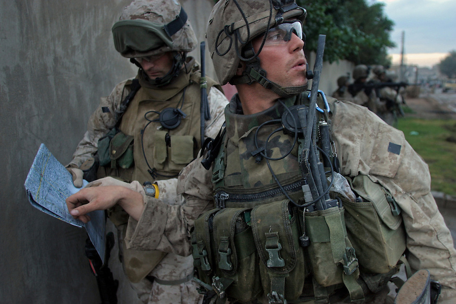 Cpl. Robert Mitchell confers with his platoon commander 1st Lt. Jesse Grapes during the first morning of the November 2004 assault on Fallujah.