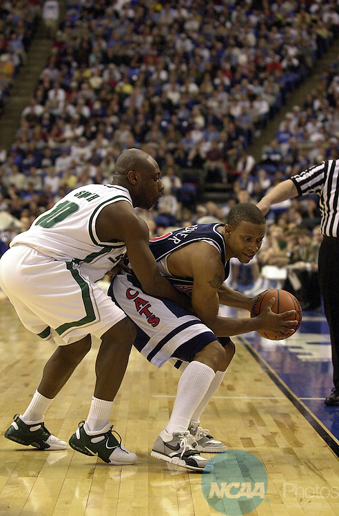 31 MAR 2001:  Michigan State guard Brandon Smith (10) reaches around University of Arizona guard Jason Garner (22) in attempt to steal the ball during the Division 1 semifinal game of the Men's Final Four Basketball Championship held at the Hubert H. Humphrey  Metrodome in Minneapolis, MN. Arizona defeated Michigan St. 80-61 to advance to the Championship game. Ryan McKee/NCAA Photos.DIGITAL IMAGE ONLY