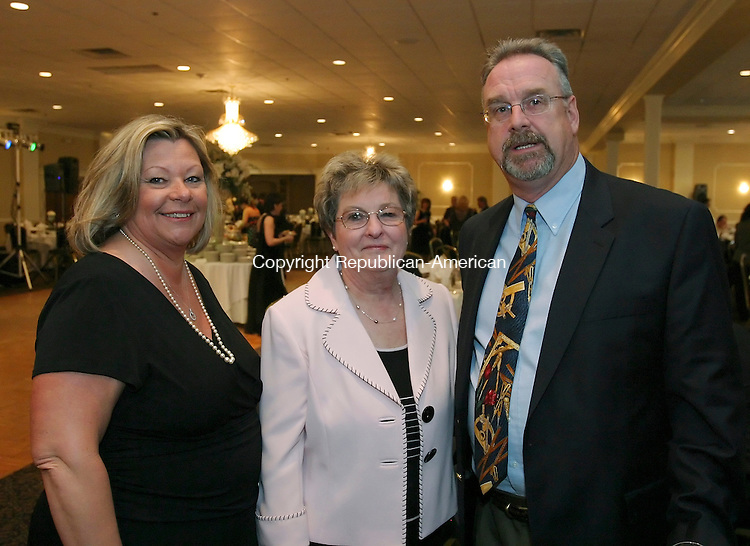 WATERBURY, CT 03/29/08- 032908BZ08- From left- Justine Kuncas, of Watertown, Julie Bion, principal of St. Mary Magdalen School, and Al Kuncas, of Watertown, Kuncas Associates, <br /> during the 8th Annual St. Mary Magdalen School Auction and Dinner at the Villa Rosa Saturday night.<br /> Jamison C. Bazinet Republican-American