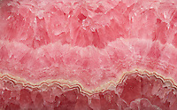 Cross-section of banded rhodochrosite, a manganese carbonate mineral. Rhodochrosite is a national symbol of Argentina. It is also the official state mineral of Colorado. Mina Capillitas, Argentina
