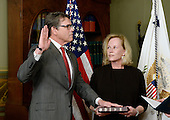Former Governor Rick Perry (Republican of Texas), left, is sworn in to be United States Secretary of Energy by US Vice President Mike Pence (R) as his wife Anita holds a bible, on March 2, 2017 in Washington, DC. <br /> Credit: Olivier Douliery / Pool via CNP