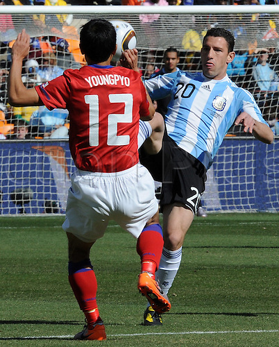 South Korea's Lee Young Pyo (L) vies for the ball with Argentina's Maxi Rodriguez during the 2010 FIFA World Cup group B match between Argentina and South Korea at Soccer City Stadium in Johannesburg, South Africa 17 June 2010.