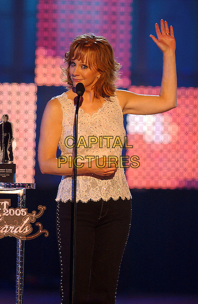 REBA McENTIRE.2005 CMT Music Awards held at the Gaylord Entertainment Center, Nashville, Tennessee, USA, .11 April 2005..half length on stage waving.Ref: ADM.www.capitalpictures.com.sales@capitalpictures.com.©Laura Farr/AdMedia/Capital Pictures.