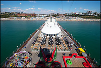 BNPS.co.uk (01202 558833)<br /> Pic: PhilYeomans/BNPS<br /> <br /> Pier view from the zip wire.<br /> <br /> The summer heatwave is leading to a 'bumper year' for tourism at Britain's premier seaside resort.<br /> <br /> Over 100,000 people are visiting Bournemouth, Dorset, every weekend and hotels are full to capacity, with restaurants packed and huge queues at ice cream stalls.<br /> <br /> Seafront kiosks are selling out of parasols and sun cream, while one bike hire company has reported a 50 per cent increase in business.