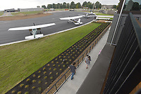 NWA Democrat-Gazette/FLIP PUTTHOFF <br />Visitors on Saturday Oct. 6 2018 look at aircraft during the grand opening of Thaden Fieldhouse at the Bentonville airport. A balcony features a view of the taxiway and runway. There's also an exhibit hangar, cafe and retail shop. The fieldhouse is also home of the OZ1 Flying Club.