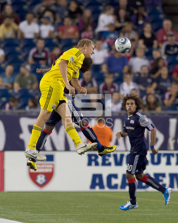 Columbus Crew forward Steven Lenhart (32) and New England Revolution midfielder Sainey Nyassi (17) battle for head ball. The New England Revolution tied Columbus Crew, 2-2, at Gillette Stadium on September 25, 2010.