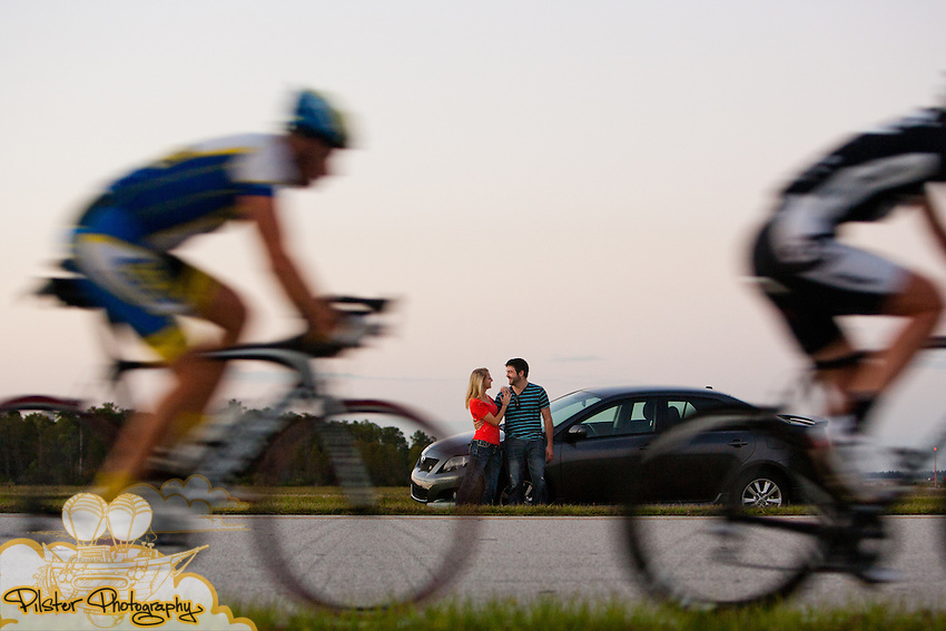 Kelly Ciepcielinski and David Hosmer watch planes take off and bicycles ride by during their engagement session on Wednesday, October 27, 2011 at the Orlando International Airport, in Orlando, Florida (Chad Pilster of http://www.PilsterPhotography.net)