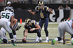 Football - NFL- Seattle Seahawks at St. Louis Rams.St. Louis Rams quarterback Sam Bradford (8) signals to his team as he readies to take the snap from St. Louis Rams center Robert Turner (59) in the third quarter at the Edward Jones Dome in St. Louis.  The Rams defeated the Seahawks, 19-13.