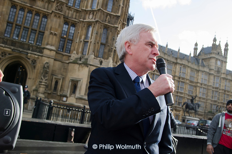 John McDonnell MP addresses a rally outside Parliament during a 3 Cosas Campaign open-top bus tour by outsourced cleaning, security and maintenance workers employed by Cofely GDF-Suez at London University, on strike over union recognition, job losses and conditions of employment.  The mostly Latin-American employees are members of the IWGB union and have already won a pay increase to the London Living Wage.