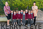Principal Lucy O'Sullivan and Class teacher Norita Cashman with her new junior infants front l-r Lily O'Donoghue, Mark O'Donoghue, Lea Guerineau and Shay Dennehy back l-r Molly Kennedy, Fionn Murphy, Amy O'Connor, Odhran Kelly and Zara Nagle on their first day of school in Knockanes NS last Monday.