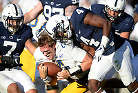 Penn State LB Koa Farmer (7) and S Nick Scott (4) hit Pitt QB Max Browne (4) after his helmet came off during a QB run. The Penn State Nittany Lions defeated the Pittsburgh Panthers 33-14 in the Keystone Classic September 9, 2017 at Beaver Stadium in State College, PA.