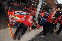 Apr 20, 2007; Avondale, AZ, USA; Crew members works on the front splitter on the car of Nascar Nextel Cup Series driver Jeff Gordon (24) during practice for the Subway Fresh Fit 500 at Phoenix International Raceway. Mandatory Credit: Mark J. Rebilas