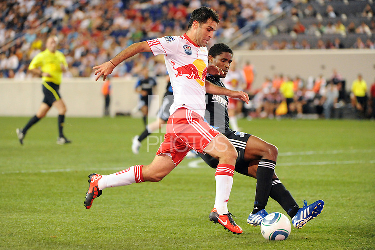 Rafael Marquez (4) of the New York Red Bulls under pressure from Brandon McDonald (14) of the San Jose Earthquakes. The New York Red Bulls defeated the San Jose Earthquakes 2-0 during a Major League Soccer (MLS) match at Red Bull Arena in Harrison, NJ, on August 28, 2010.