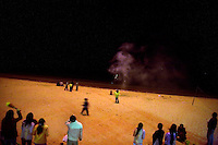 People light off fireworks to celebrate the Lunar New Year on a beach in Da Dong Hai, Sanya, China.