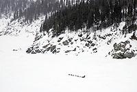 Paul Gebhardt runs along the coastline on the Bering Sea ice after leaving Elim on tuesday