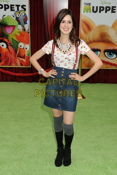 "Laura Marano.""The Muppets"" Los Angeles Premiere held at the El Capitan Theatre, Hollywood, California, USA..November 12th, 2011.full length  white top jean denim skirt suspenders braces hands on hips socks black grey gray.CAP/ADM/BP.©Byron Purvis/AdMedia/Capital Pictures."