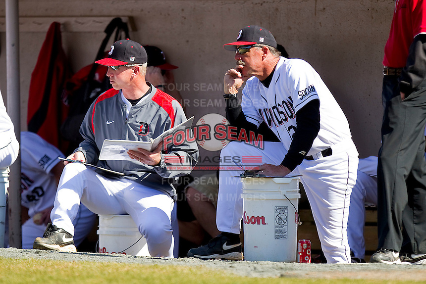 (L-R) Davidson Wildcats assistant coach Mike Zandler and head coach Dick Cooke #25 watch the action during the game against the College of Charleston Cougars at Wilson Field on March 12, 2011 in Davidson, North Carolina.  The Wildcats defeated the Cougars 8-3.  Photo by Brian Westerholt / Four Seam Images